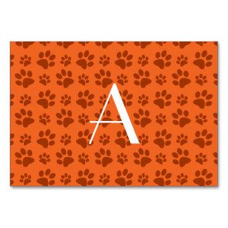 Monogram orange dog paw prints table card