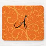 Monogram orange swirls mouse pad