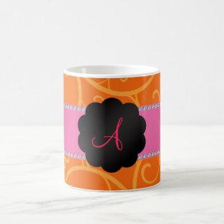 Monogram orange swirls coffee mugs
