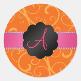 Monogram orange swirls round stickers