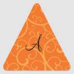 Monogram orange swirls triangle sticker