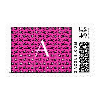 Monogram pink skulls pattern postage stamp