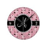 Monogram pretty pink eiffel tower pattern round clocks
