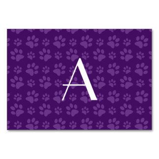 Monogram purple dog paw prints table card