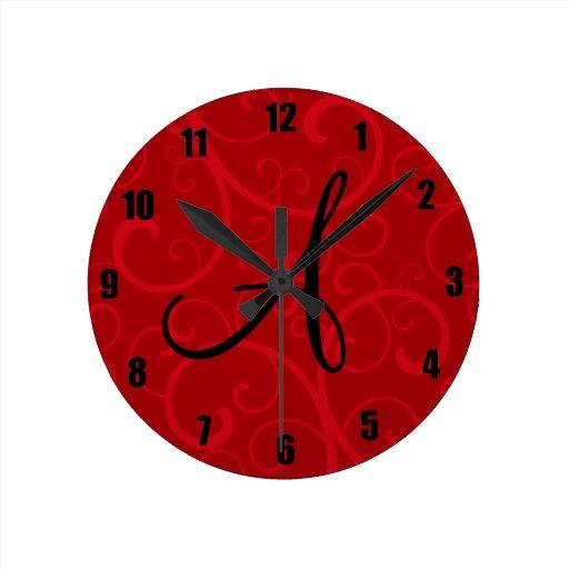 Monogram red swirls round wallclocks