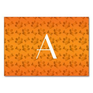 Monogram shiny orange dog paw prints table cards