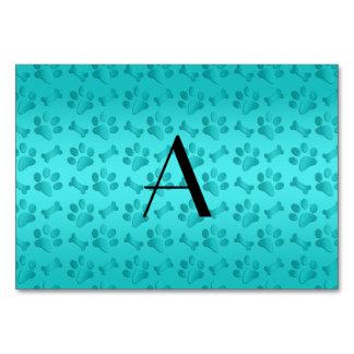 Monogram shiny turquoise dog paw prints table card