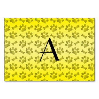 Monogram shiny yellow dog paw prints table card