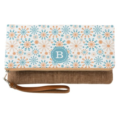 Monogram Teal and orange color bursts in abstract Clutch