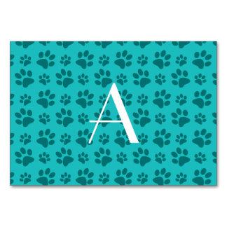 Monogram turquoise dog paw prints table cards