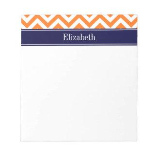 Monograma anaranjado del nombre de la marina de bloc de notas