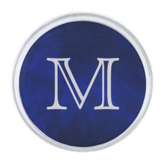 Monograma azul de la plata del resplandor insignia plateada