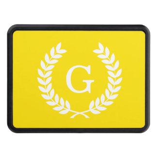 Monograma blanco amarillo de la inicial de la tapas de remolque