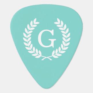 Monograma blanco de la inicial de la guirnalda del uñeta de guitarra
