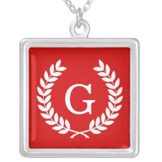 Monograma blanco rojo de la inicial de la joyería