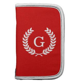 Monograma blanco rojo de la inicial de la planificadores