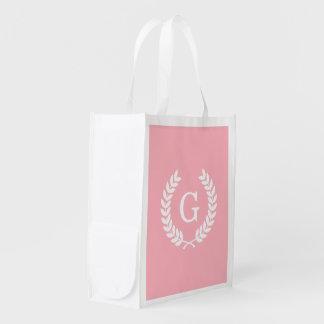Monograma blanco rosado de la inicial de la bolsas reutilizables