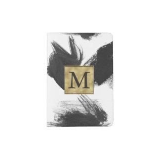 Monograma blanco y negro del extracto de la porta pasaporte