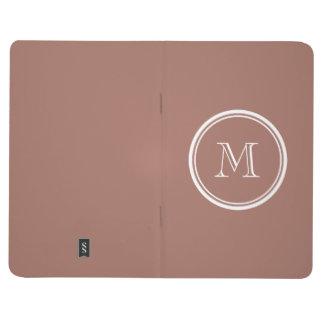 Monograma coloreado parte alta de bronce cuaderno grapado