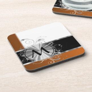 Monograma de cobre y de plata posavasos de bebidas