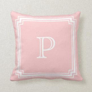 Monograma de la esquina hecho muescas en del fondo almohadas