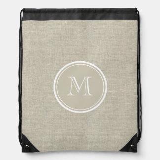 Monograma de lino beige rústico del fondo mochilas