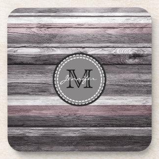 Monograma de madera de la mirada de los colores posavasos