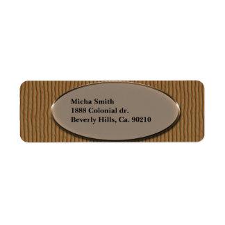 Monograma de madera surcado de la textura etiqueta de remite