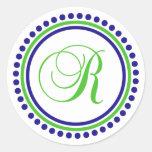 Monograma de R (círculo del punto del azul marino/ Etiqueta