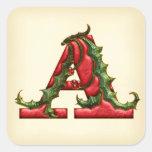 Monograma del acebo del navidad que un sobre sella pegatinas cuadradas personalizadas