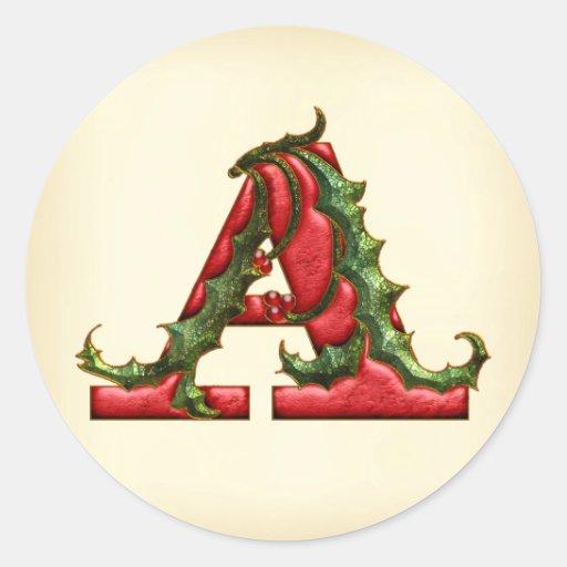 Monograma del acebo del navidad que un sobre sella etiqueta redonda