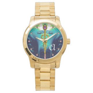 MONOGRAMA del CADUCEO del ORO, azul de la Reloj