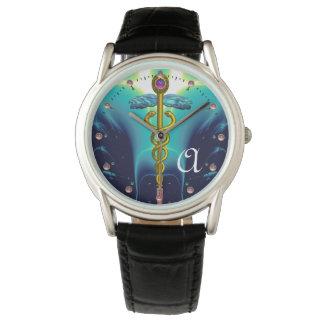 MONOGRAMA del CADUCEO del ORO, azul de la Relojes De Pulsera