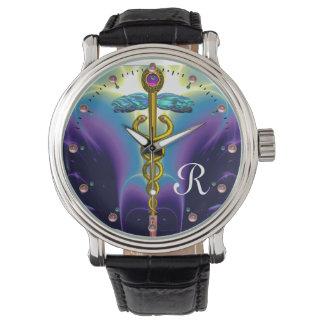 MONOGRAMA del CADUCEO del ORO, azul púrpura Reloj