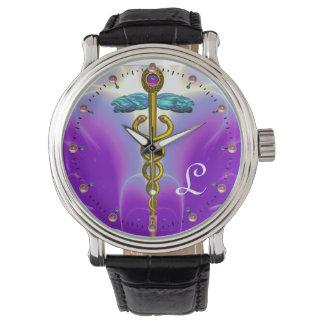 MONOGRAMA del CADUCEO del ORO, trullo púrpura Relojes