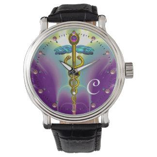 MONOGRAMA del CADUCEO del ORO, verde púrpura Relojes