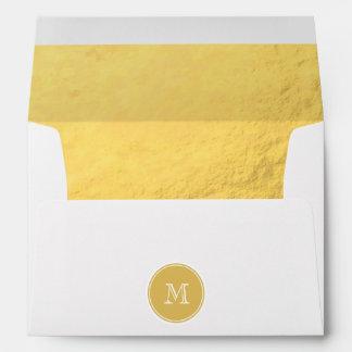Monograma del fondo de la hoja de oro del encanto sobres