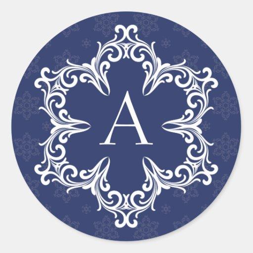 Monograma del invierno un sello en marina de pegatina redonda