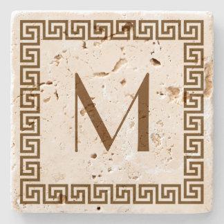 Monograma dominante griego del diseño posavasos de piedra