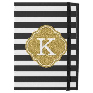 Monograma elegante del oro de las rayas negras