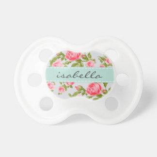 Monograma floral de los rosas femeninos del chupete de bebe
