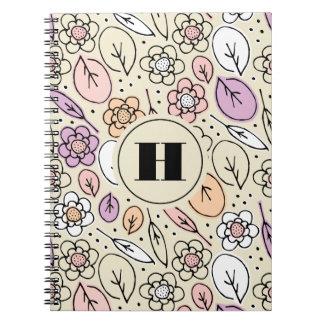 Monograma floral y de las hojas en colores pastel cuaderno
