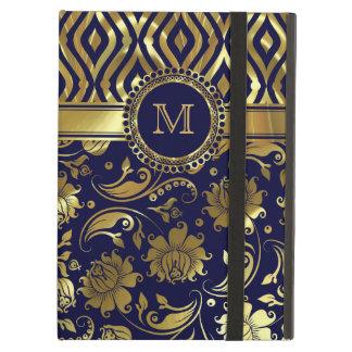 Monograma floral y geométrico del azul y del oro d