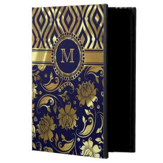 Monograma floral y geométrico del azul y del oro