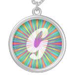 Monograma G de la explosión del arco iris Grimpolas