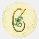 Monograma irlandés C del oro Pegatina Redonda