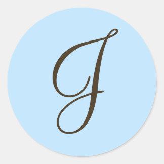 Monograma J de Brown en etiqueta azul clara del