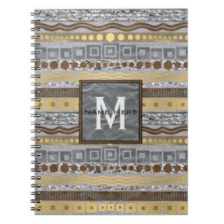 Monograma mezclado de los metales de nuevo al libros de apuntes