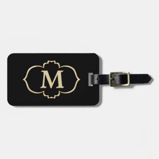 Monograma negro del marco del oro etiquetas maletas