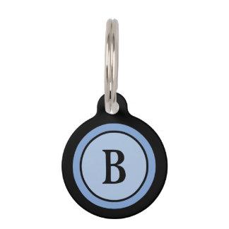 Monograma negro y azul de la etiqueta de la identi placa de mascota